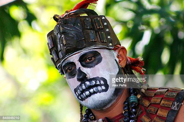 Maya of Guatemala poses for photos with his ancestral costume and his face painted on July 08 2016 in San Salvador El Salvador Members of Guatemalan...
