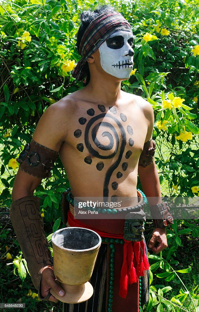 A Maya of Guatemala poses for photos with his ancestral costume and his face painted on July 08, 2016 in San Salvador, El Salvador. Members of Guatemalan Maya people participated in a presentation of the ancient and traditional Mesoamerican Ballgame which was played, according to the discoveries, by many civilizations in Mesoamerica such as Mayas, Nahuas and Olmecas.