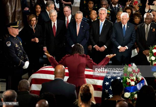 Maya Rockeymoore Cummings prays over her husband's casket Representative Elijah Cummings who lies in state within Statuary Hall during a memorial...