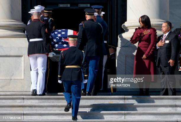 Maya Rockeymoore Cummings watches with family and friends as the casket of her her husband husband Democratic US Representative from Maryland Elijah...