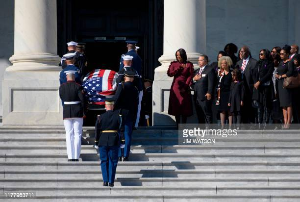 Maya Rockeymoore Cummings watches with family and friends as the casket of her husband Democratic US Representative from Maryland Elijah Cummings...