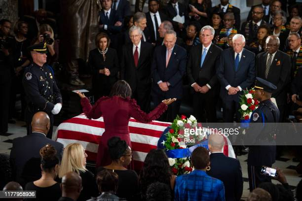 Maya Rockeymoore Cummings widow of the late Rep Elijah Cummings pauses at his casket during his memorial service at the Statuary Hall of the US...