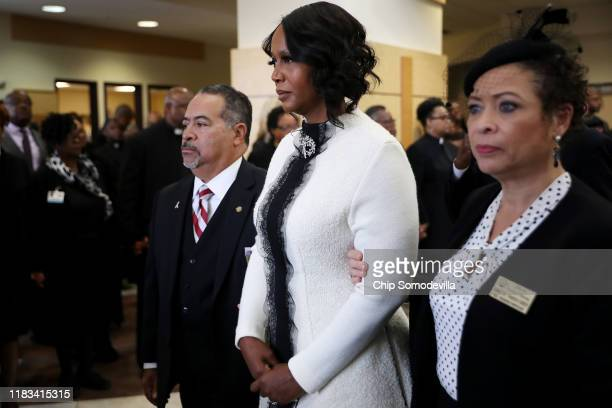 Maya Rockeymoore is escorted out of New Psalmist Baptist Church following the funeral service for her husband Rep Elijah Cummings October 25 2019 in...