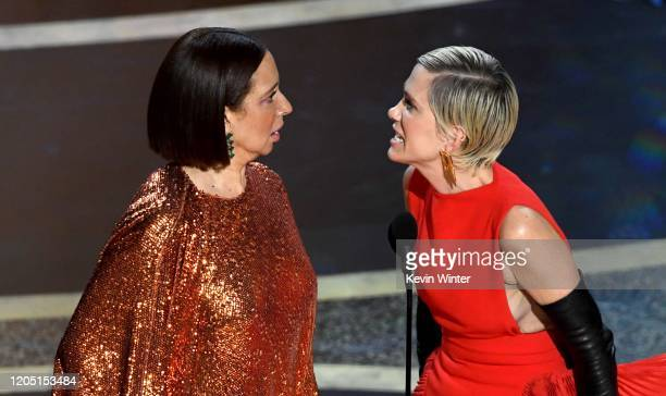 Maya Rudolph and Kristen Wiig speak onstage during the 92nd Annual Academy Awards at Dolby Theatre on February 09 2020 in Hollywood California