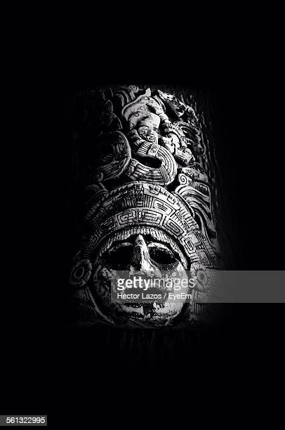 Maya Style Sculpture Over Black Background