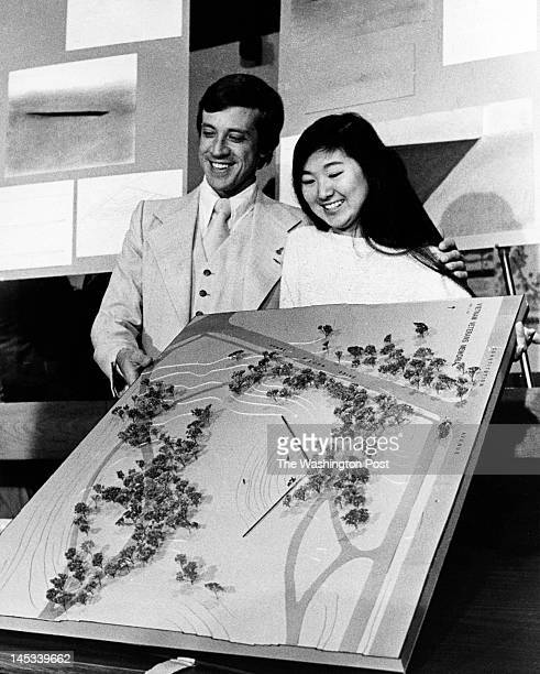 Maya Ying Lin with Jan Scruggs founder and president of the Vietnam Veterans Memorial Fund hold the model of the new Vietnam Memorial on May 6 1981