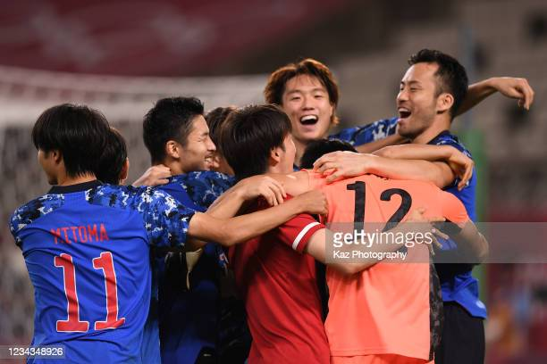 Maya Yoshida, Captain of Japan and other team mates thank to Kosei Tani who saves the penalty kick at Penalty Shoot Out during the Men's Quarter...