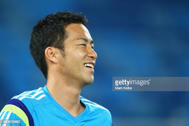 Maya Yoshida laughs during a Japan training session at the Dunas Arena in Natal on June 18 2014 in Natal Rio Grande do Norte