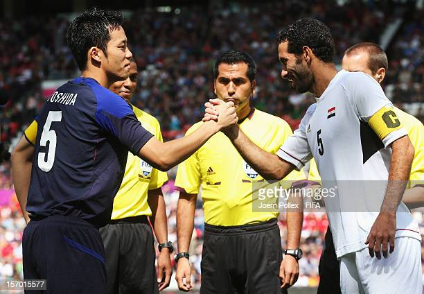 Maya Yoshida of Japan and Mohamed Aboutrika of Egypt shake hands prior to the Men's Football Quarter Final match between Japan and Egypt on Day 8 of...