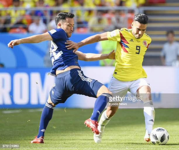 Maya Yoshida of Japan and Radamel Falcao of Colombia vie for the ball during the second half of a World Cup group stage match in Saransk Russia on...