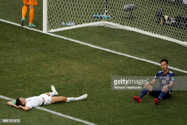 Maya Yoshida of Japan and Robert Lewandowski of Poland react during the 2018 FIFA World Cup Russia group H match between Japan and Poland at...