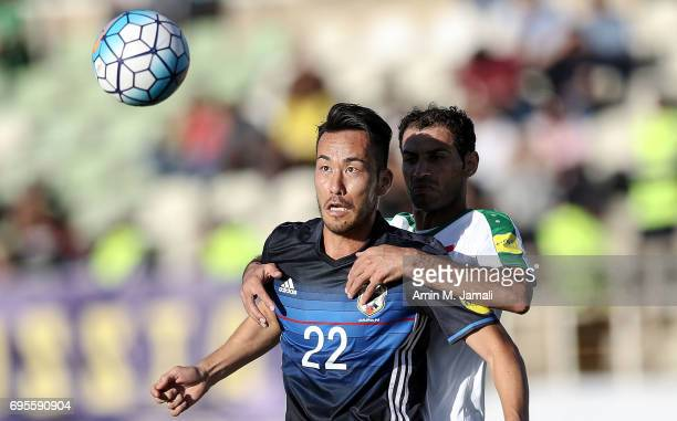 Maya Yoshida of Japan and Saad Abdolameer of Iraq in action during the FIFA World Cup Russia Asian Final Qualifier match between Iraq and Japan at...