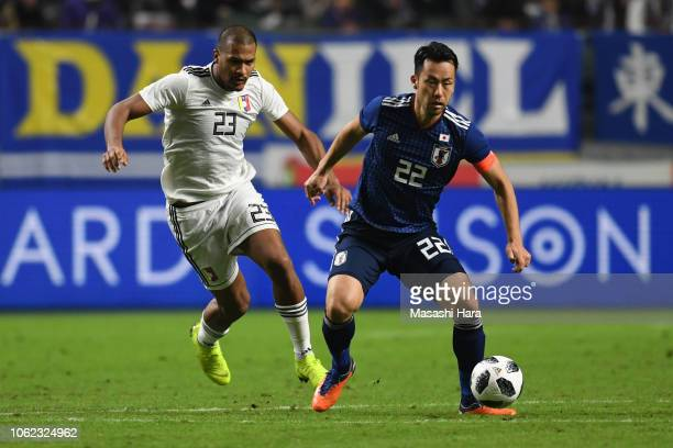 Maya Yoshida of Japan and Salomon Rondon of Venezuela compete for the ball during the international friendly match between Japan and Venezuela at...