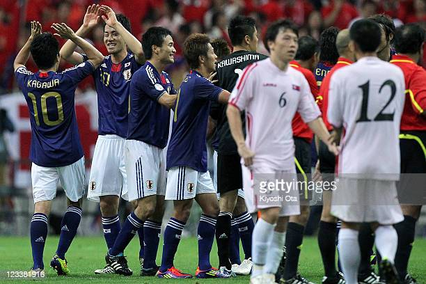Maya Yoshida of Japan celebrates with Shinji Kagawa of Japan after his team won the 2014 FIFA World Cup Brazil Asian 3rd Qualifier match between...