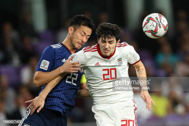 Maya Yoshida of Japan competes with Sardar Azmoun of Iran during the AFC Asian Cup semi final match between Iran and Japan at Hazza Bin Zayed Stadium...
