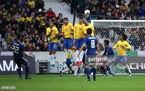 Maya Yoshida of Japan Danilo Luiz da Silva Casemiro Thiago Silva Fernandinho of Brazil during the international friendly match between Japan and...