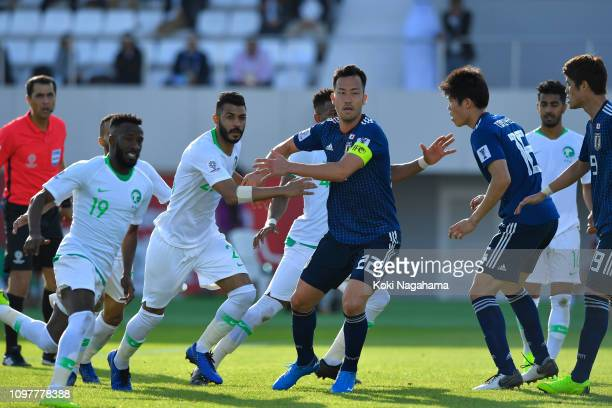 Maya Yoshida of Japan gets in position to defend a corner kick during the AFC Asian Cup round of 16 match between Japan and Saudi Arabia at Sharjah...