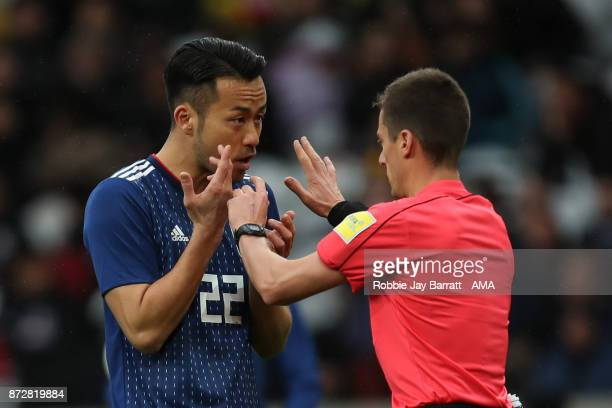 Maya Yoshida of Japan has a disagreement with Referee Benoit Bastien after a decision is made with the VAR System during the international friendly...