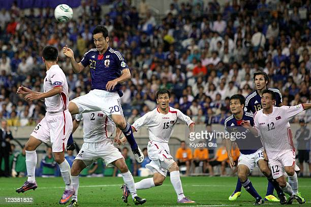 Maya Yoshida of Japan heads to score a goal against North Korea during the 2014 FIFA World Cup Brazil Asian 3rd Qualifier match between Japan and...