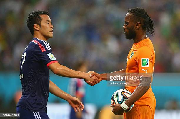 Maya Yoshida of Japan shakes hands with Didier Drogba of the Ivory Coast after the 2014 FIFA World Cup Brazil Group C match between the Ivory Coast...