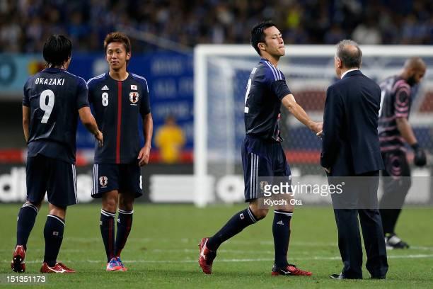 Maya Yoshida of Japan shakes hands with head coach Alberto Zaccheroni of Japan after the international friendly match between Japan and UAE at Tohoku...