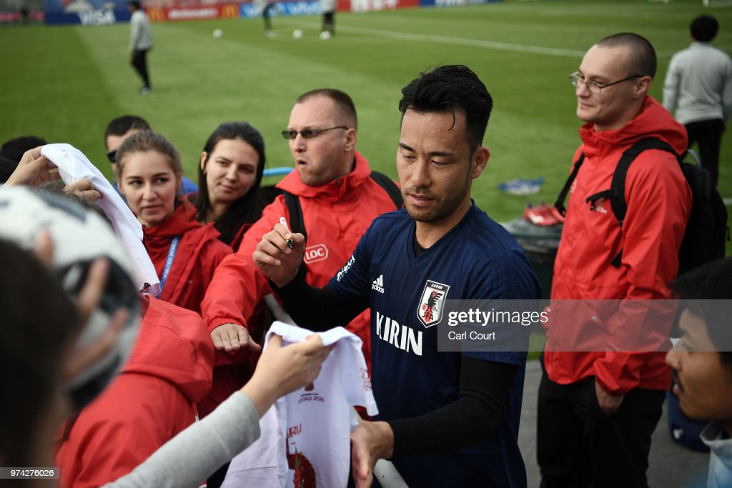 Maya Yoshida of Japan signs autographs after a training session on June 14, 2018 in Kazan, Russia.