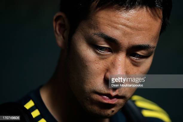 Maya Yoshida of Japan speaks to the media after the Japan Training Session at the Confederations Cup 2013 at Centro de Capacitacao Fisica dos...