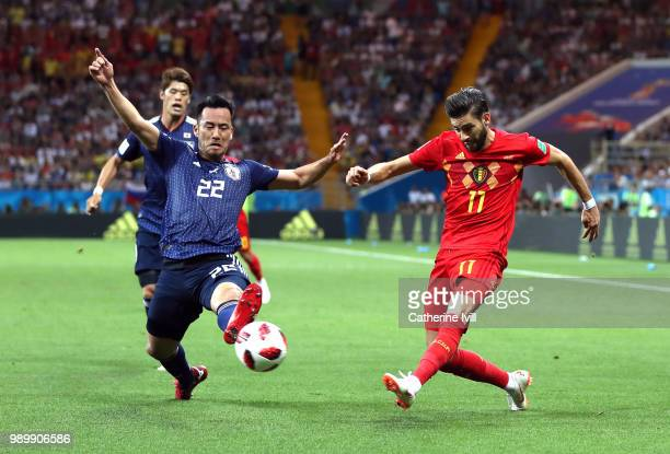 Maya Yoshida of Japan tries to block a cross from Yannick Carrasco of Belgium during the 2018 FIFA World Cup Russia Round of 16 match between Belgium...