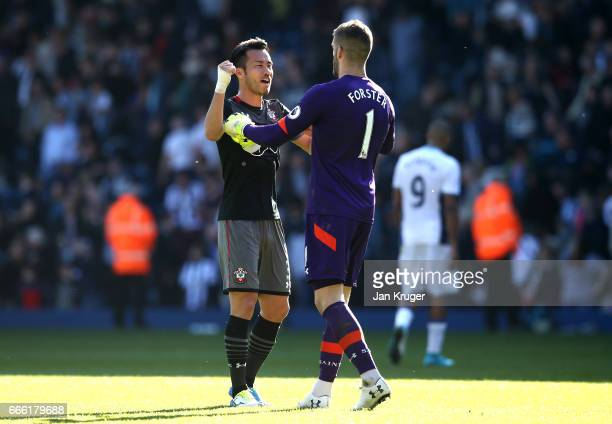 Maya Yoshida of Southampton and Fraser Forster of Southampton celebrate after the Premier League match between West Bromwich Albion and Southampton...