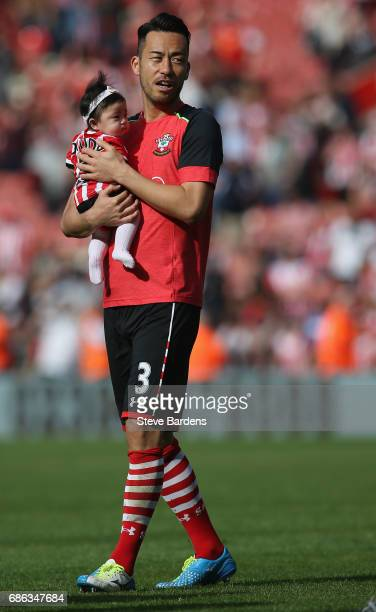 Maya Yoshida of Southampton and his young baby take part in a lap of appreciation after the Premier League match between Southampton and Stoke City...