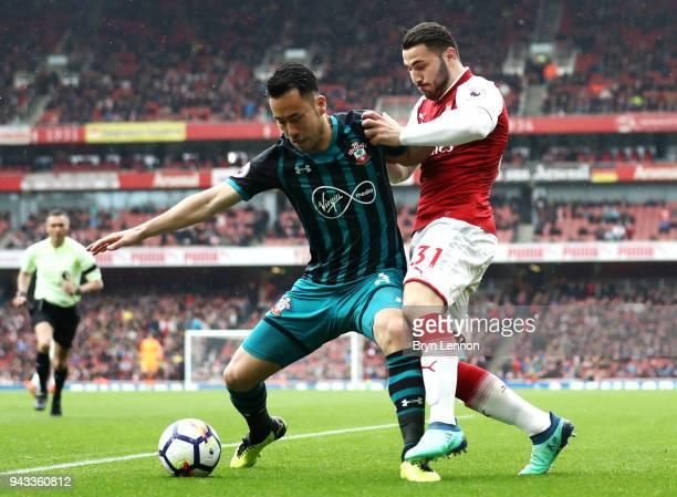 Maya Yoshida of Southampton and Sead Kolasinac of Arsenal battle for possession during the Premier League match between Arsenal and Southampton at...