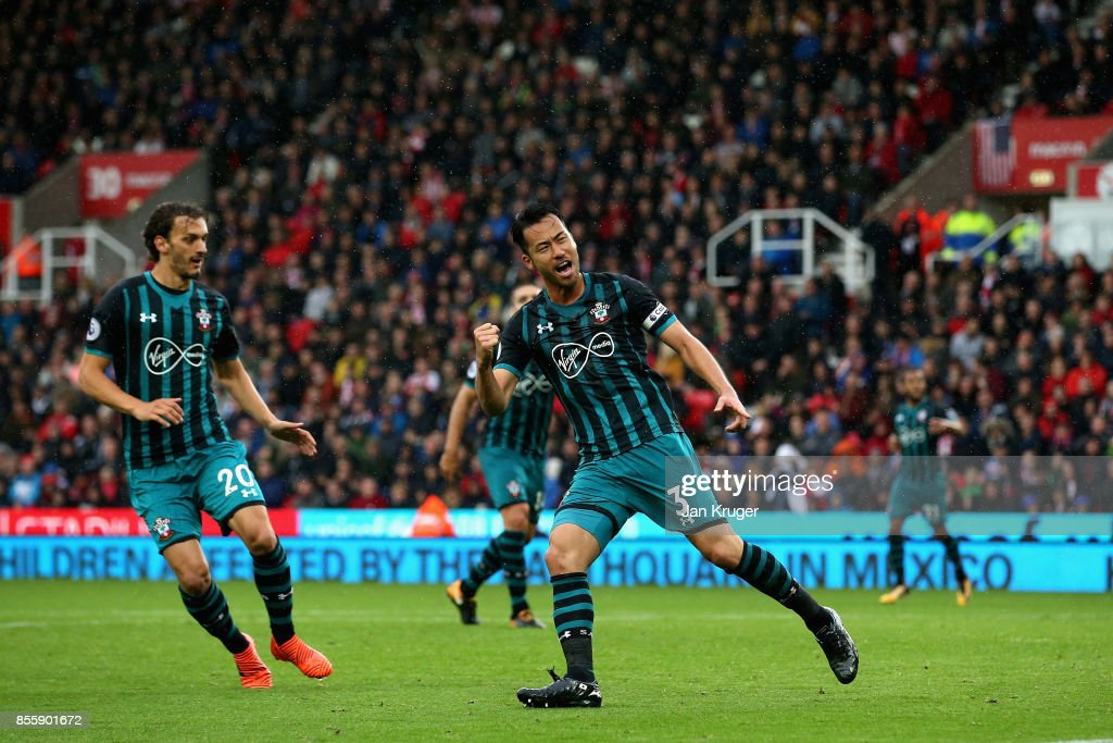 Maya Yoshida of Southampton celebrates scoring his side's first goal during the Premier League match between Stoke City and Southampton at Bet365 Stadium on September 30, 2017 in Stoke on Trent, England.