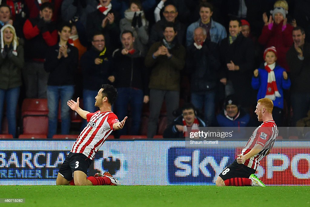 Maya Yoshida of Southampton (L) celebrates scoring their third goal during the Barclays Premier League match between Southampton and Everton at St Mary's Stadium on December 20, 2014 in Southampton, England.
