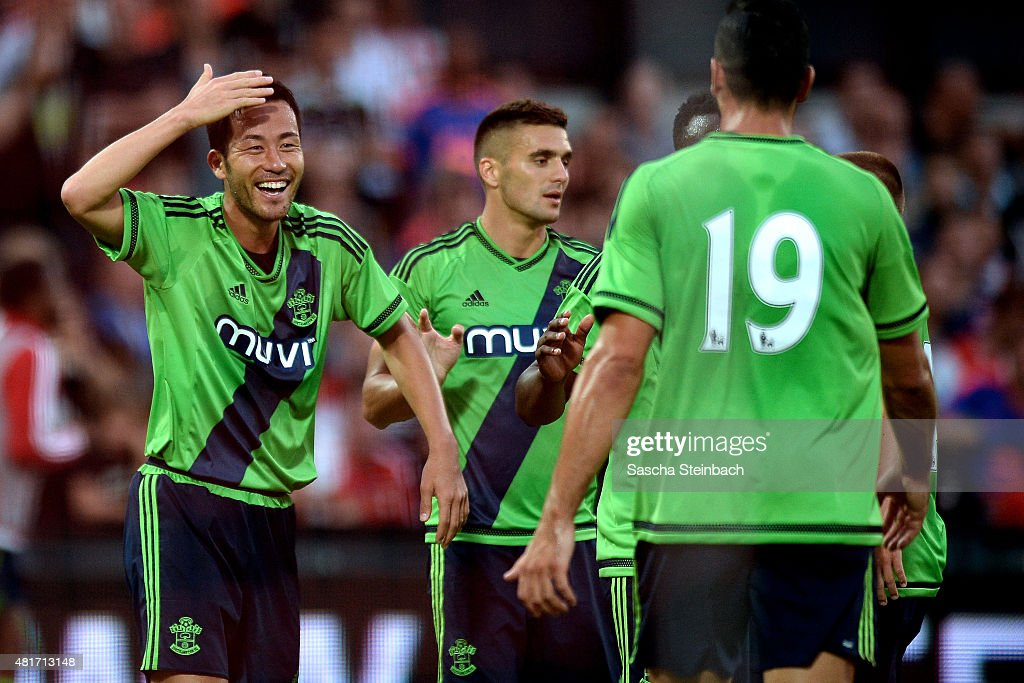 Maya Yoshida (L) of Southampton celebrates with team mates after scoring his team's second goal during the pre season friendly match between Feyenoord Rotterdam and Southampton FC at De Kuip on July 23, 2015 in Rotterdam, Netherlands.