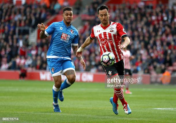 Maya Yoshida of Southampton clears the ball from Joshua King of AFC Bournemouth during the Premier League match between Southampton and AFC...
