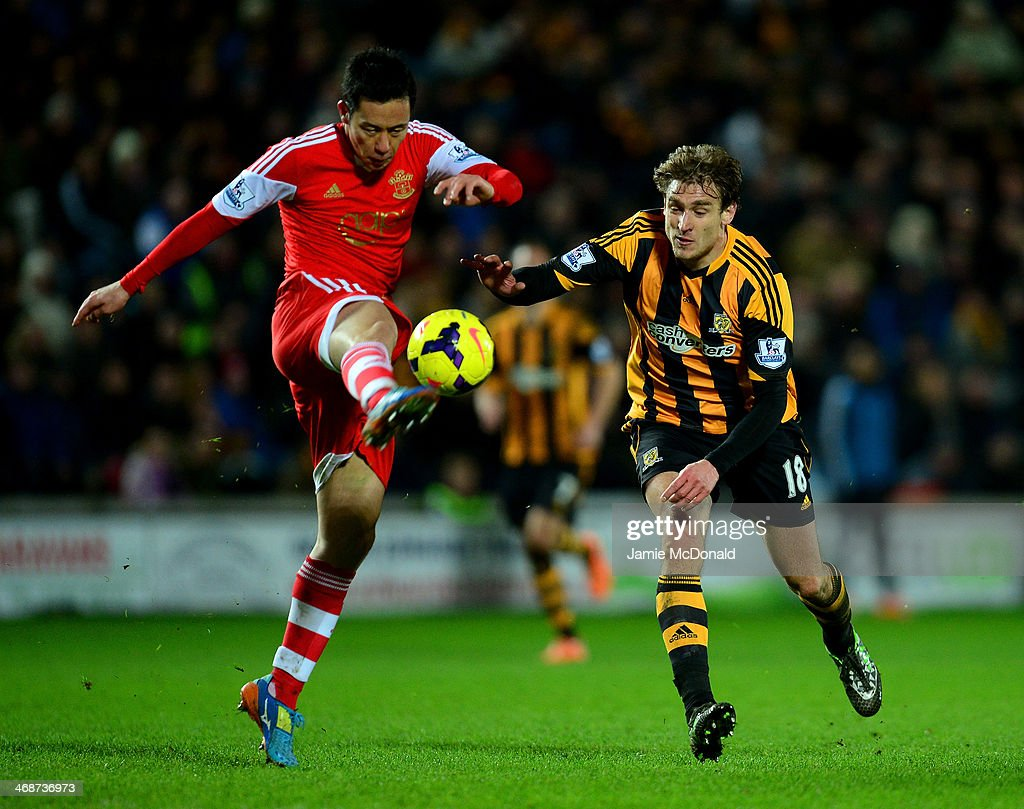 Maya Yoshida of Southampton controls the ball under pressure from Nikica Jelavic of Hull City during the Barclays Premier League match between Hull City and Southampton at the KC Stadium on February 11, 2014 in Hull, England.