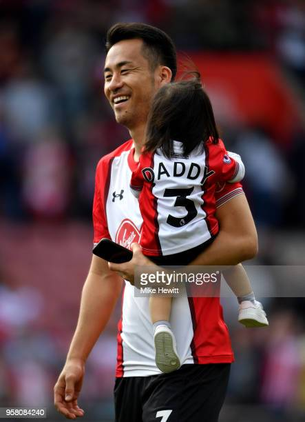 Maya Yoshida of Southampton enjoys the lap of honour with his child after the Premier League match between Southampton and Manchester City at St...