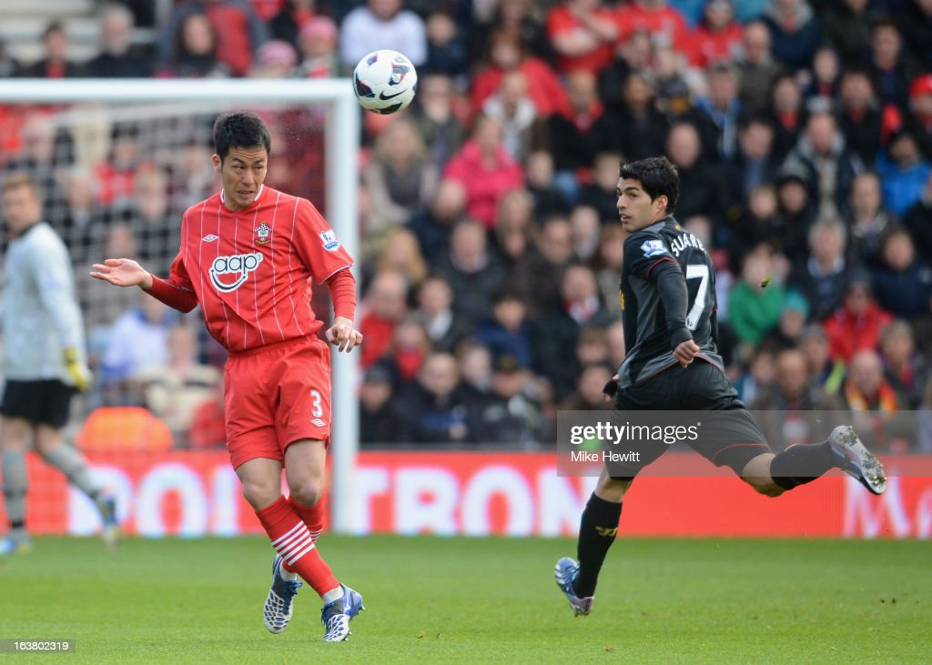 Maya Yoshida of Southampton heads clear from Luis Suarez of Liverpool during the Barclays Premier League match between Southampton and Liverpool at St Mary's Stadium on March 16, 2013 in Southampton, England.