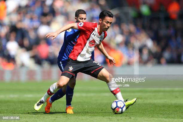 Maya Yoshida of Southampton is challenged by Eden Hazard of Chelsea during the Premier League match between Southampton and Chelsea at St Mary's...