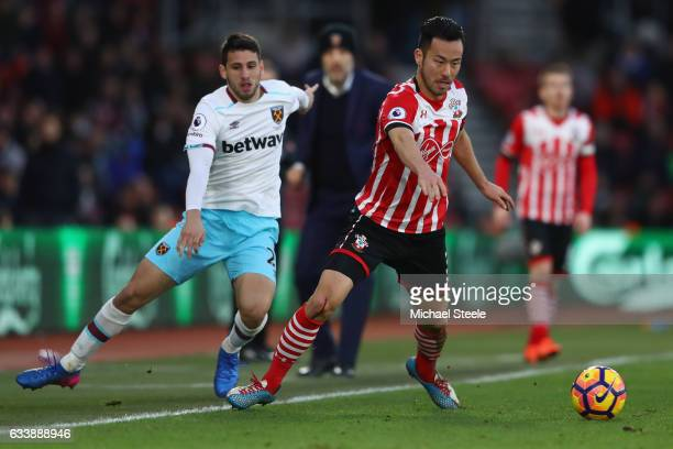 Maya Yoshida of Southampton is tracked by Jonathan Calleri of West Ham United during the Premier League match between Southampton and West Ham United...