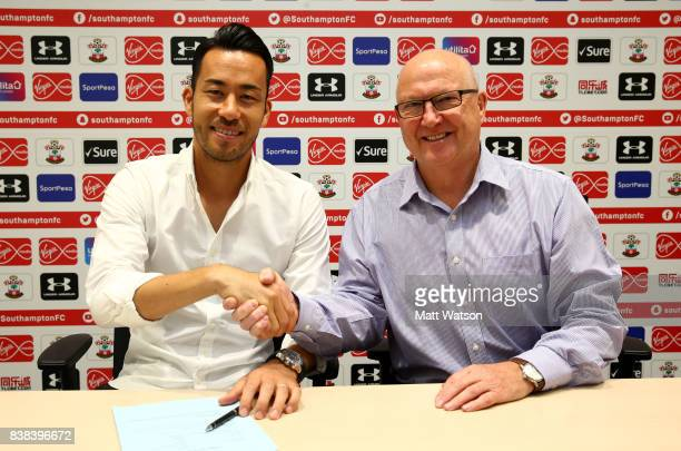 Maya Yoshida of Southampton poses with director Les Reed after signing a new contract at the Staplewood Campus on August 24 2017 in Southampton...