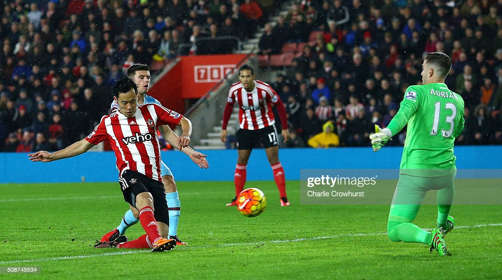 Maya Yoshida of Southampton shoots past Adrian of West Ham United to score their first goal during the Barclays Premier League match between Southampton and West Ham United at St Mary's Stadium on February 6, 2016 in Southampton, England.