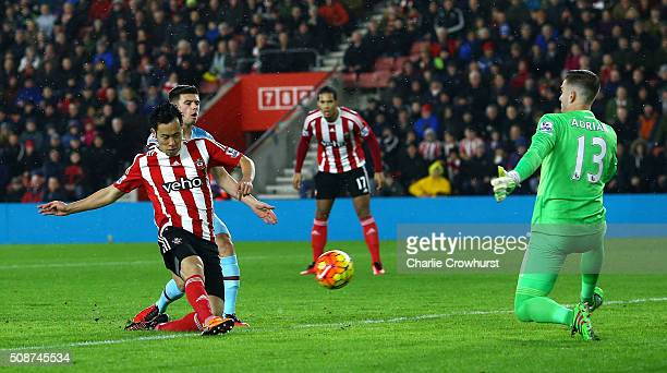 Maya Yoshida of Southampton shoots past Adrian of West Ham United to score their first goal during the Barclays Premier League match between...
