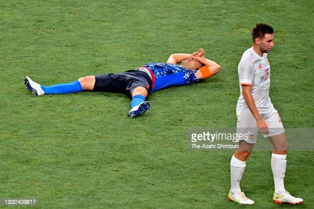 Maya Yoshida of Team Japan shows dejection after his side's 0-1 defeat in the Men's Football Semi-final match between Japan and Spain on day eleven...