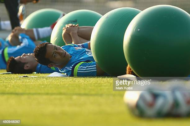 Maya Yoshida stretches during a Japan training session at the Japan national team base camp at the Spa Sport Resort on June 20 2014 in Itu Sao Paulo