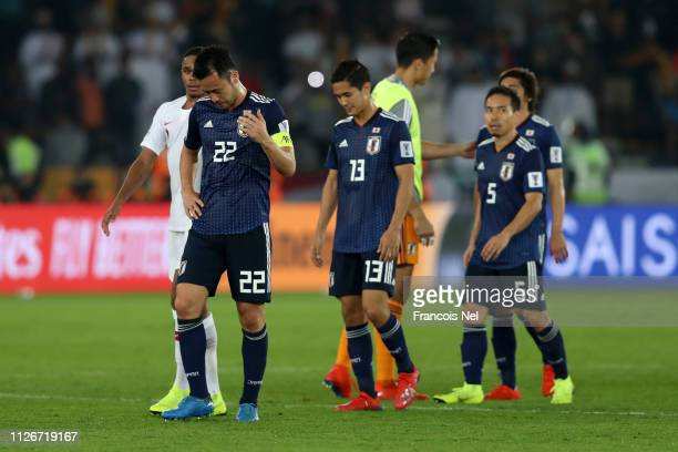 Maya Yoshida Yoshinori Muto and Yuto Nagatomo of Japan look dejected following their sides defeat in the AFC Asian Cup final match between Japan and...