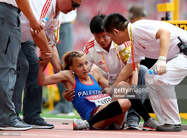 Mayada Al Sayed of Palestine collapses with exhaustion after crossing the finish line in the Women's Marathon final during day nine of the 15th IAAF...