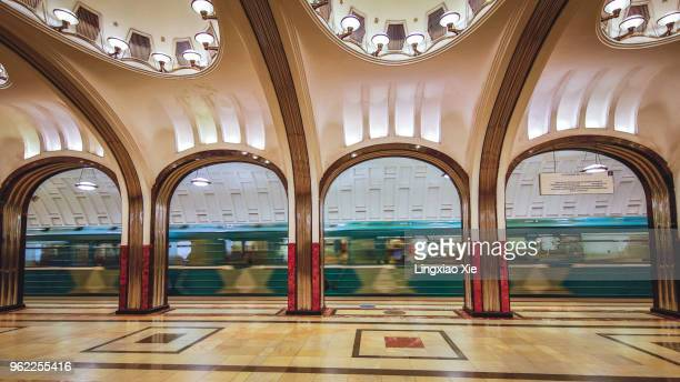 mayakovskaya metro station with train running through, moscow, russia - moscow metro stock pictures, royalty-free photos & images