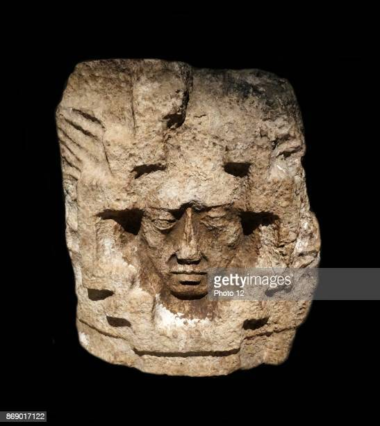 Mayan architectural detail of a face from a facade in calcified rock Yucatan Mexico 600900 AD