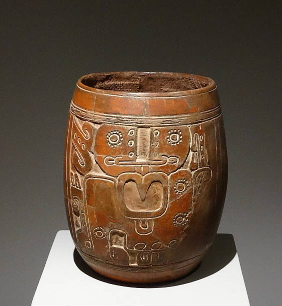 Mayan Ceramic Vase With An Engraved Figure Of A God With A Large